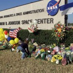 Flowers and Memorial gifts for the Columbia Crew line the entrance to Johnson Space Center shortly after the accident. (Courtesy of NASA)