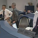 Workers in Mission Control wait for a signal from the Columbia crew minutes before the scheduled landing on February 1, 2003. The signal never comes and entry flight director Leroy Cain holds his hand over his face when he realizes Columbia is lost. (Courtesy of NASA)
